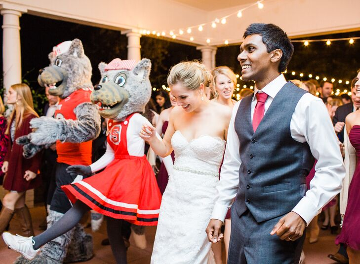 """Our wedding planner had our alma mater's mascots surprise us and all the guests,"" Allison says. Many of the wedding guests were NC State graduates, so this nostalgic addition made their big day even more sentimental."