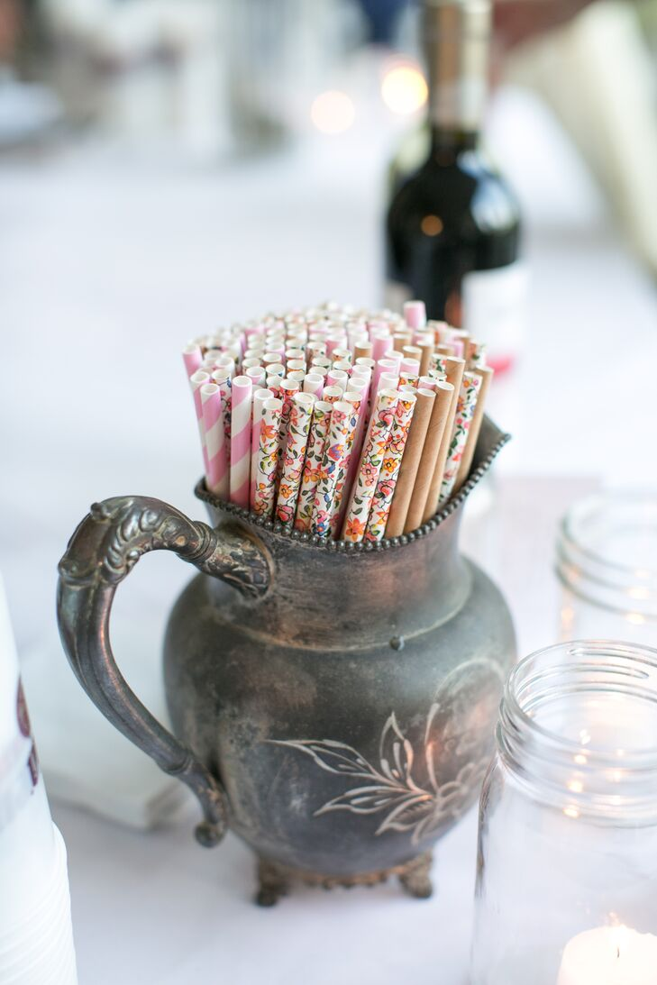 Floral and striped paper straws were displayed in a rustic, vintage creamer.