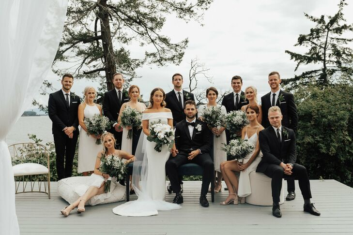 Elegant Wedding Party with Black Tuxedos and White Gowns