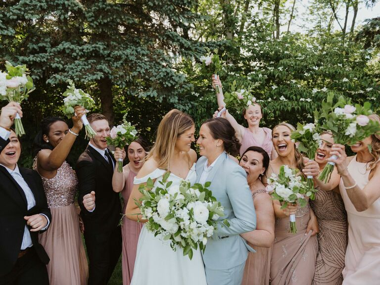 Funny bridesmaid picture with groomsmen and couple