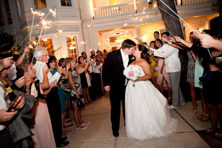 Kate and Frank exited their reception to an aisle of sparklers.