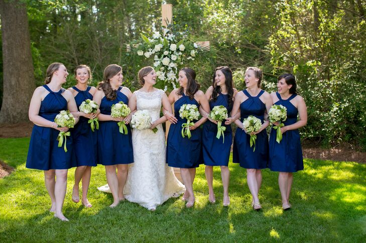 The bridesmaids' short navy blue dresses from David's Bridal contrasted with their green and ivory bouquets.
