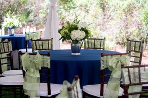 Navy Linens with Ivory and Green Centerpieces in Antique Vases