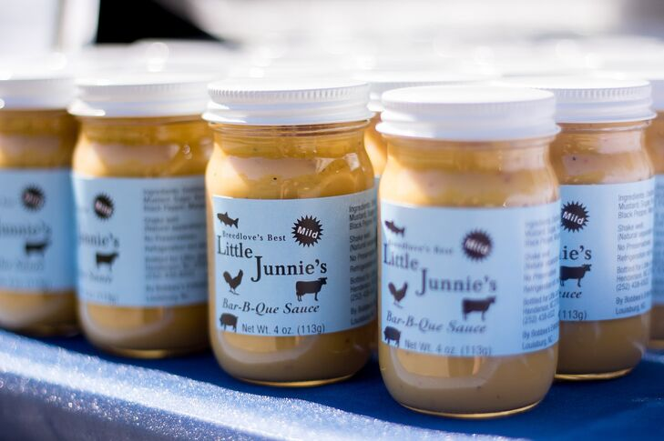 "The groom's grandfather makes and sells his own barbecue sauce that the couple bottled to give as favors. ""We loved this as a way to incorporate both our family and our North Carolina roots!"" says Elizabeth."