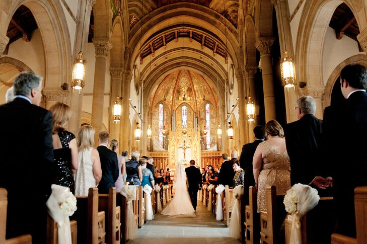 St. Bernard's Parish in Pittsburgh, Pennsylvania, didn't need much in the way of decoration. The couple placed bows at the end of alternating pews for a delicate effect.