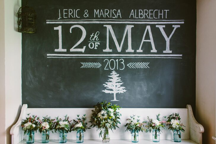 A large chalkboard with the couple's names and the date of the wedding was displayed at the venue.