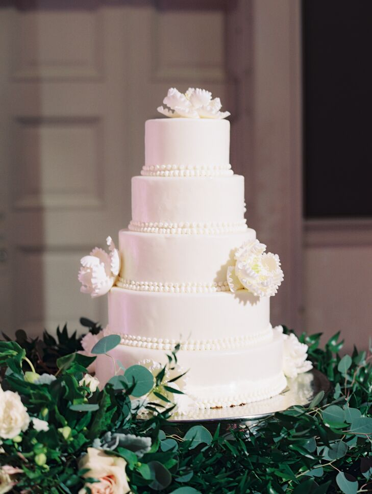 It took the catering company two tries to nail Caroline's aunt's wedding cake recipe. But in the end, the five-tier all-white confection tasted just like home. Delicate sugar flowers and fondant beading finished the look.