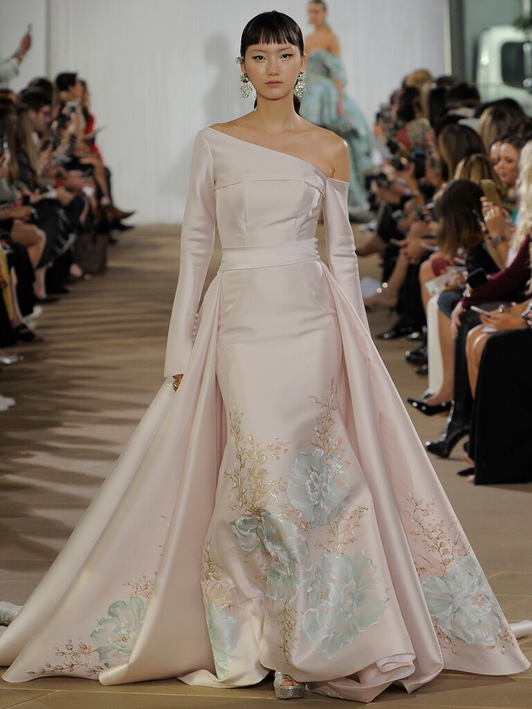 Ines Di Santo Fall 2019 asymmetrical blush wedding dress with long sleeves, multicolored pastel oversized floral-printed skirt and a cape detail