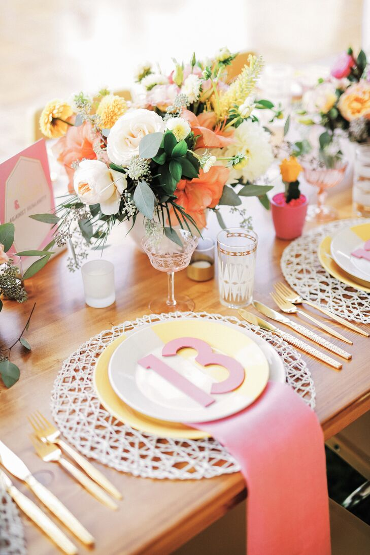 Yellow, orange and white flowers topped each table, and place settings were delightfully midcentury modern, perfect for the Palm Springs setting. Each setting included a woven white charger, gold flatware and graphically patterned glassware.