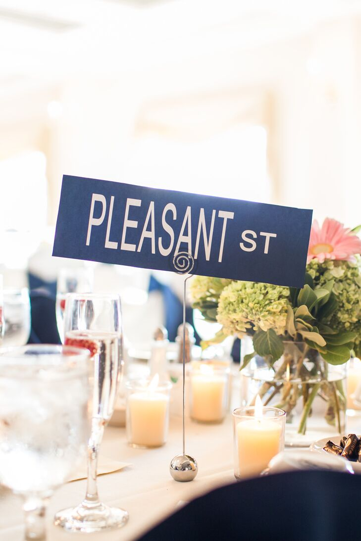 Each navy table card sign was named after a street address.