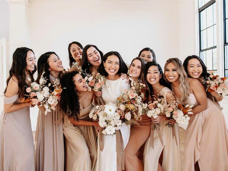 Bridesmaids posing with bride on wedding day