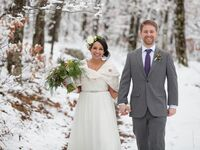 wedding couple walking in snow
