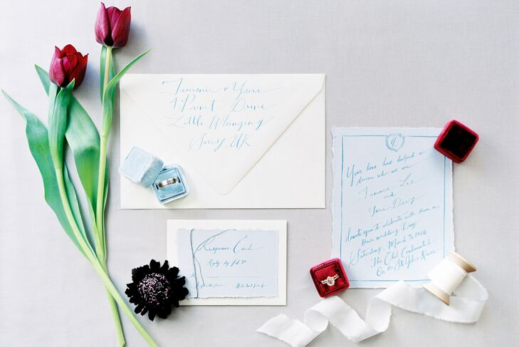 """A very talented and sweet calligraphy artist, Molly, made our watercolor-penned invite suite,"" Tammie says. ""The invites and RSVP cards were on dusty blue hand-torn paper, and we paired them with cream-colored envelopes."""