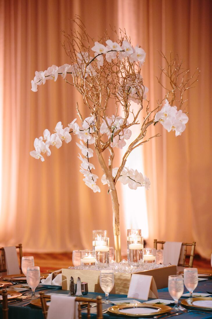 Astounding Gold Branches And Orchid Centerpiece Home Interior And Landscaping Ferensignezvosmurscom