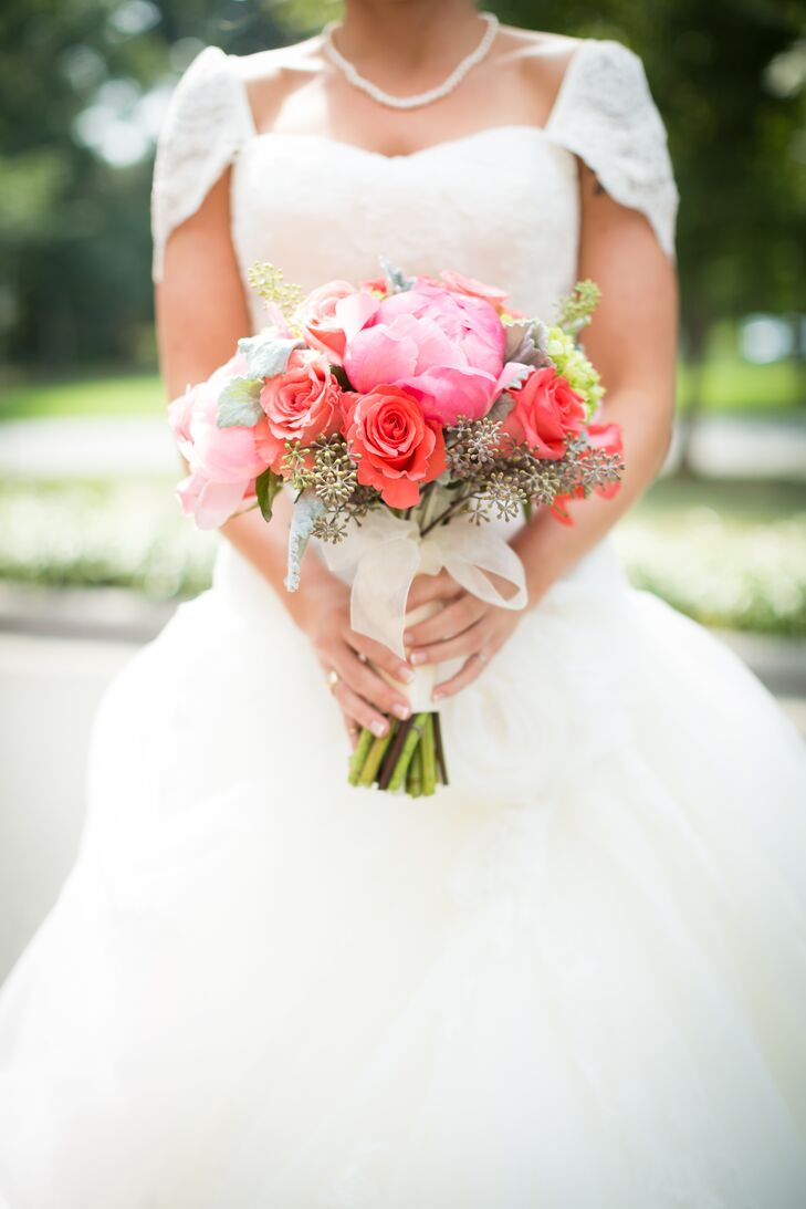 Peonies are one of Mallory's favorite flowers, so having them in her bouquet was a must. Bright pink peonies, red roses, baby's breath and green hydrangeas filled her bouquet.