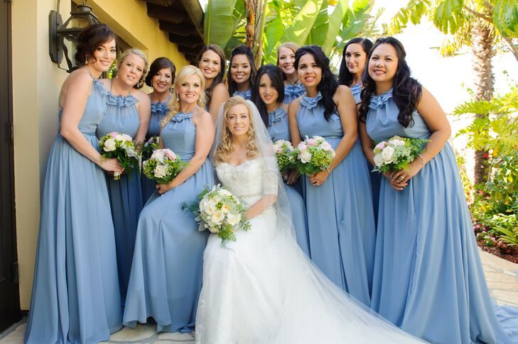 """Jill wanted her best friends to feel beautiful and romantic,"" the couple says. ""With sparkly shoes and crystal earrings, they each looked like a vision of Cinderella. Jill's matrons of honor, her sister-in-law and best friend, wore sparkly belts to set them apart."""