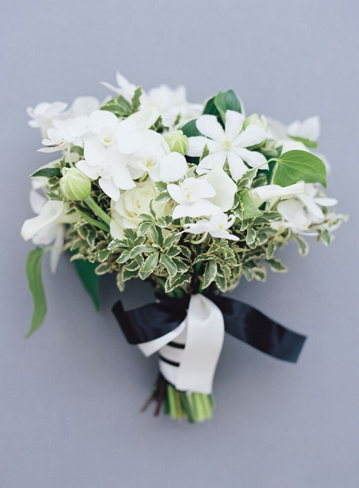 Bouquet of White Blossoms and Greenery Tied with Black and White Ribbon