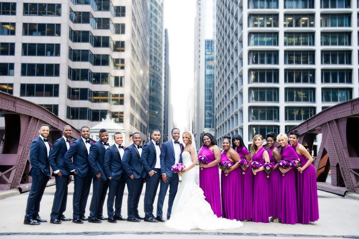 Felicia's favorite flower was the inspiration behind the fuchsia bridesmaid dresses, which were perfectly paired with navy tuxedos.