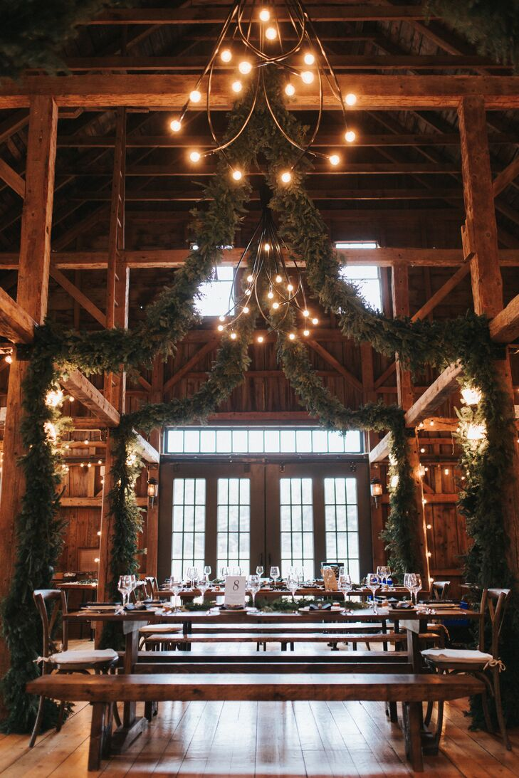 The Barn at Flanagan Farm provided a blank canvas for Shane and Lexie to make their own. Highlighting the winter season and Maine's natural landscape, the couple adorned the rafters of the lofty barn with dramatic garlands made with cedar, evergreen and pine that infused the room with a fresh, earthy scent.