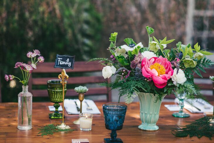 Vintage medicine bottles served as vases, adding to the tablescape of candles, colorful water goblets, potted terra-cotta succulents and mini potted rosemary and thyme.