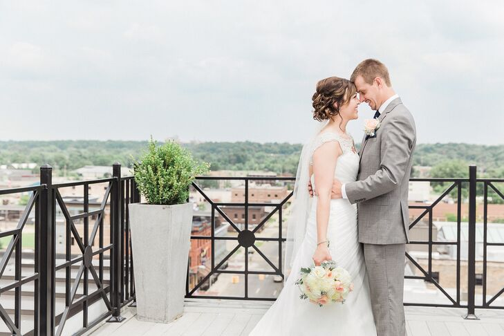 Amber and Adam were married atop SkyDeck, a rooftop bar in downtown Kalamazoo, Michigan. The space offered spectacular views of the city to their guests.