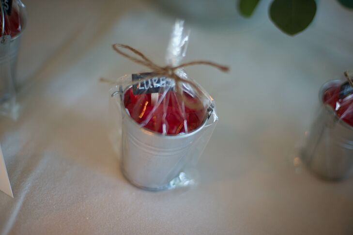 """Since Todd's favorite candy is Swedish fish, our wedding favors were little silver pales filled with the candy and sign that said 'lures,'"" says Karen."
