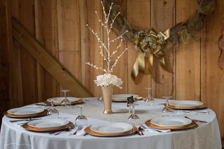The exquisite centerpieces were a collaborative effort  by Taylor and her mom. Sparkly gold branches were placed in gold mercury-glass vases for an ephemeral effect.