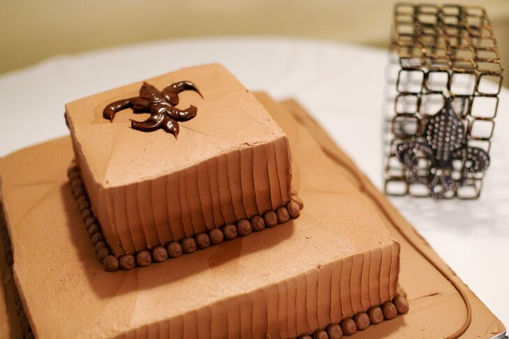 The couple also had a two-tier chocolate groom's cake with peanut butter frosting and a piped fleur-de-lis design.
