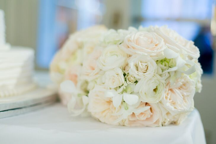 The bridesmaids carried white bouquets of roses, hydrangeas, garden roses and peonies.