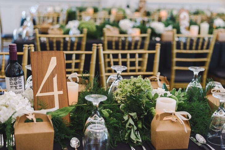 """I requested all tables to be arranged as long rectangular banquet tables and for everyone in the bridal party to sit together at a head table,"" Vanessa says. ""I wanted an intimate family-seating feeling. All tables were lined with matching garlands and candles."""