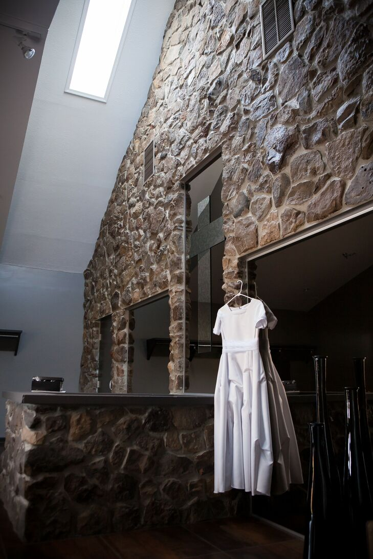 Kristina wore an ivory long wedding dress with sleeves and a ruffled skirt.
