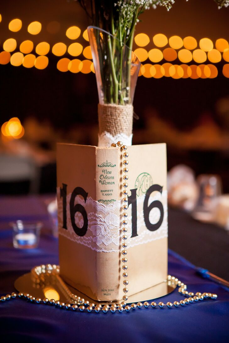 Vintage books draped with beads served as table numbers, which went around the centerpiece vases.