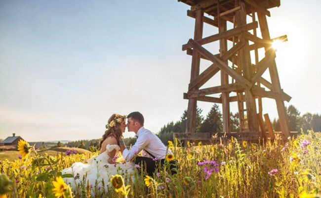 Audrey and Jeremy Roloff sit in a field on their wedding day