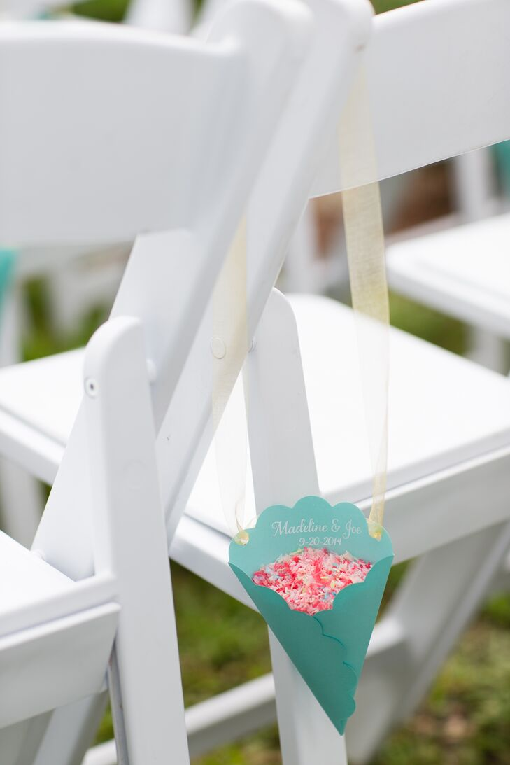 Madeline and Joe placed turquoise paper cones on the back of each chair at the ceremony. They were each filled with pink confetti for guests to throw in celebration of the newlyweds.