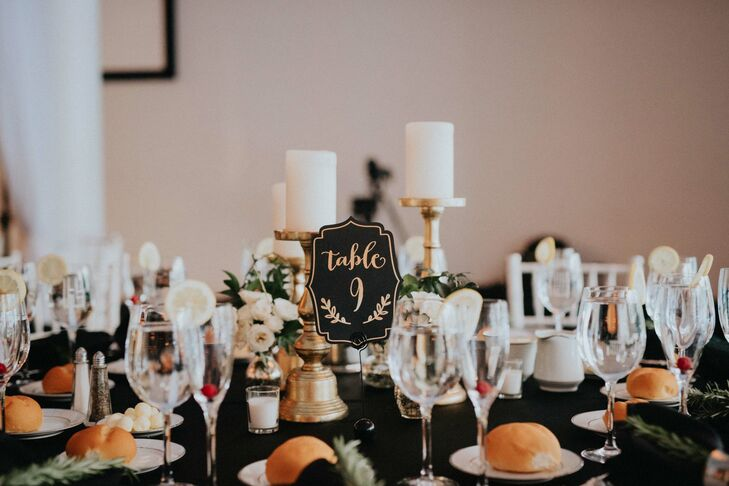 Playing off the elegant gold accents and bold black linens, the fanciful table numbers were done up in black and gold and featured flourishes and whimsical script that reflected the evening's rustic, contemporary feel.