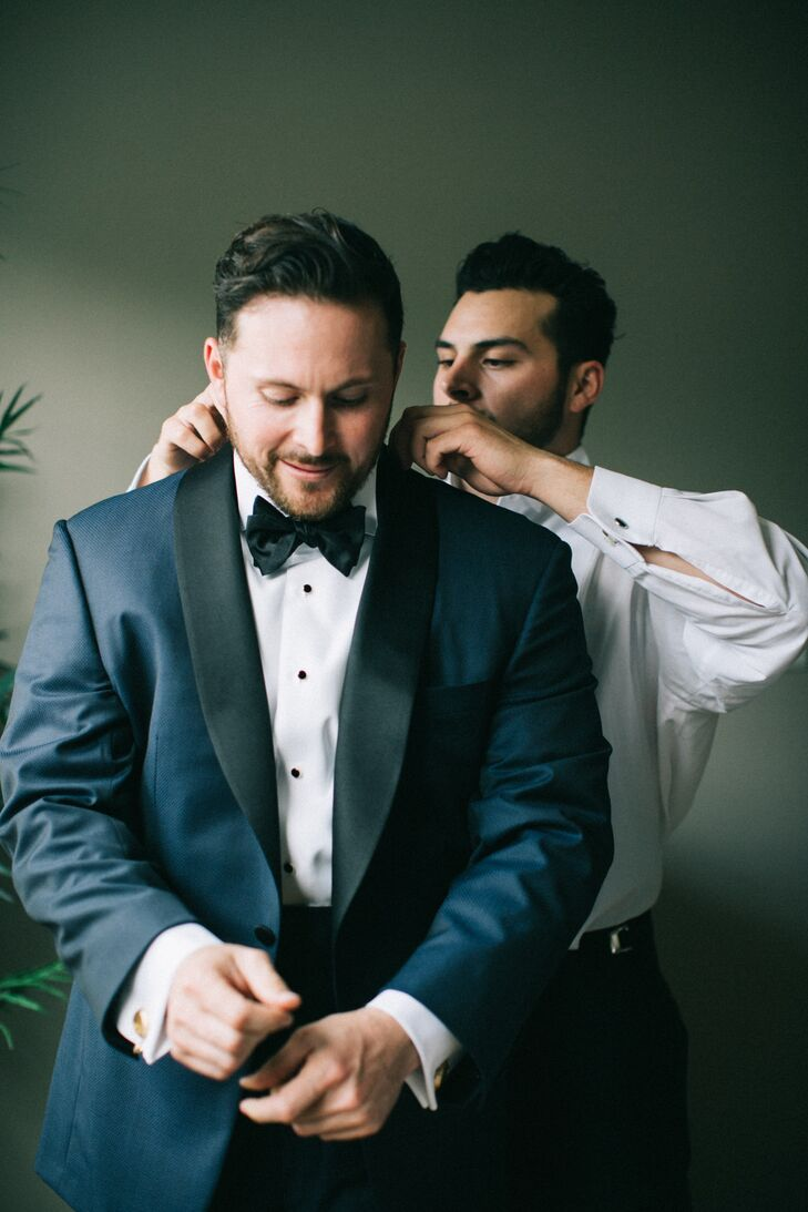 "As for the groom, he wore a navy blue custom-made tuxedo. ""It was a lot of fun getting to pick that out together,"" Dawn says."