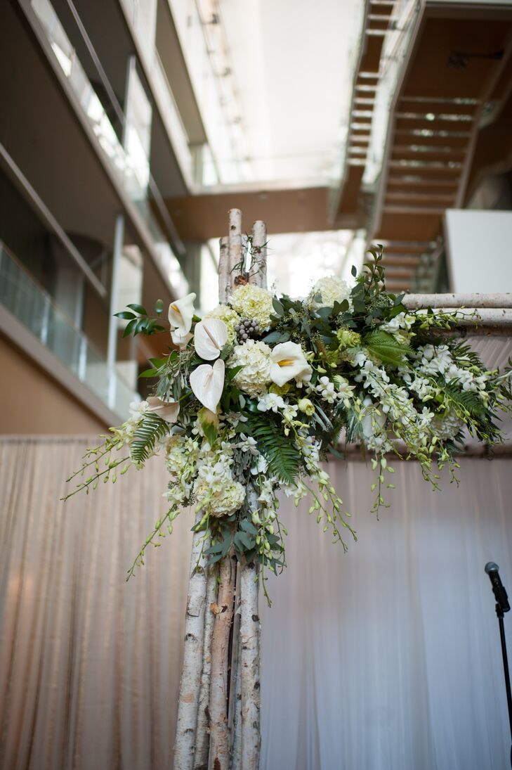 Marisa and Dan stood under a chuppah (a traditional Jewish wedding canopy) made of birch wood and draped in asymmetrical blooms. The stage was raised, so no one strained to see.
