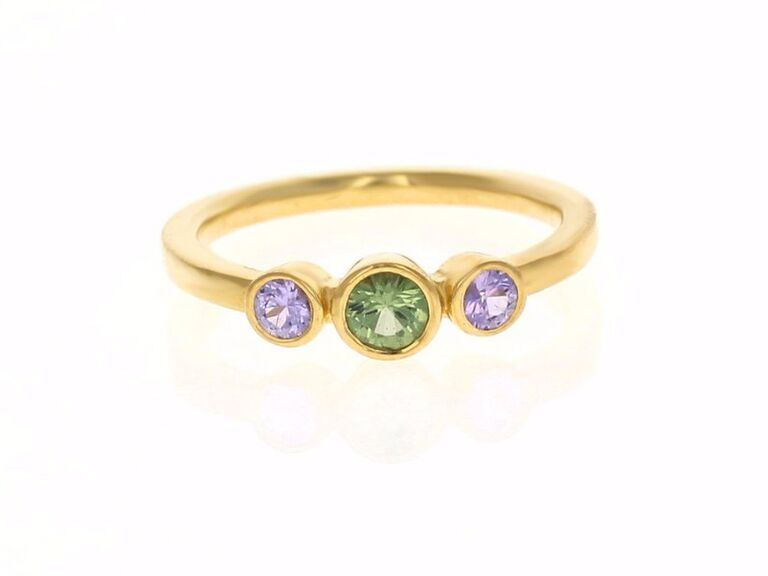 Three-stone mint and sapphire gold engagement ring