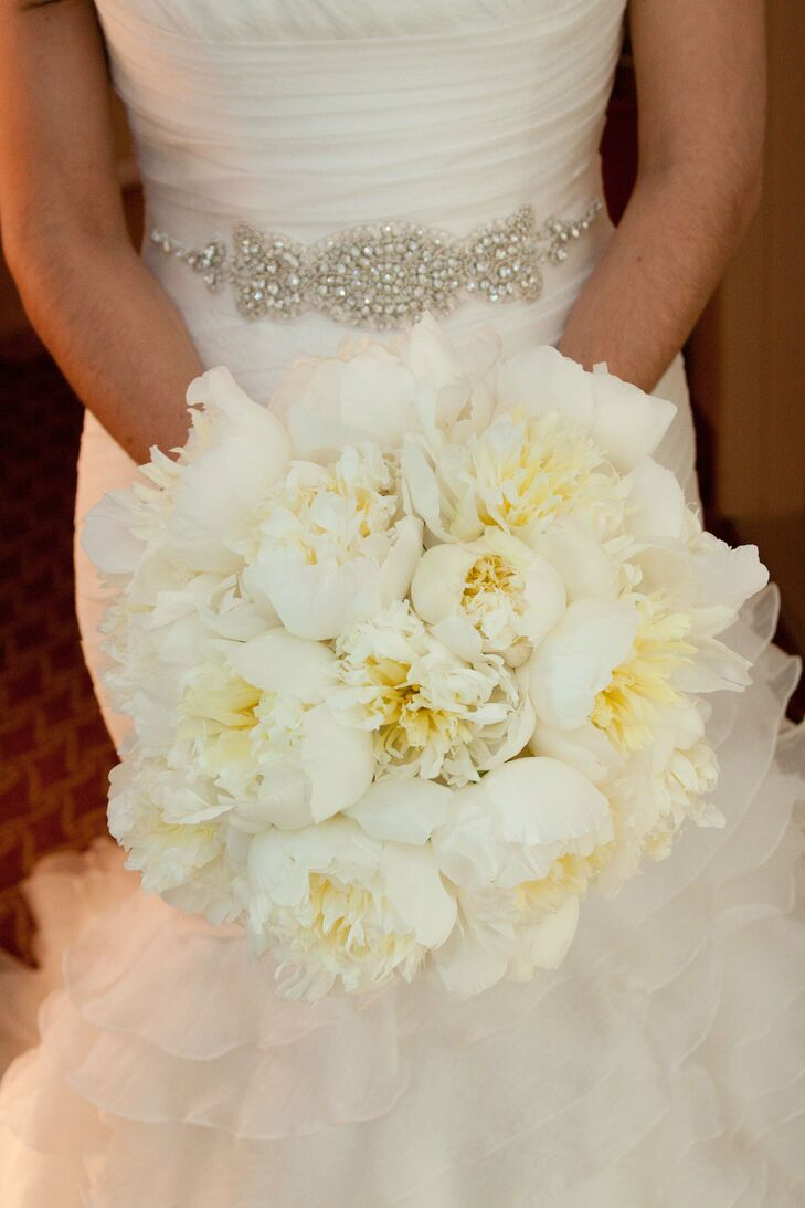 Kate carried a round, fluffy bouquet of white peonies.