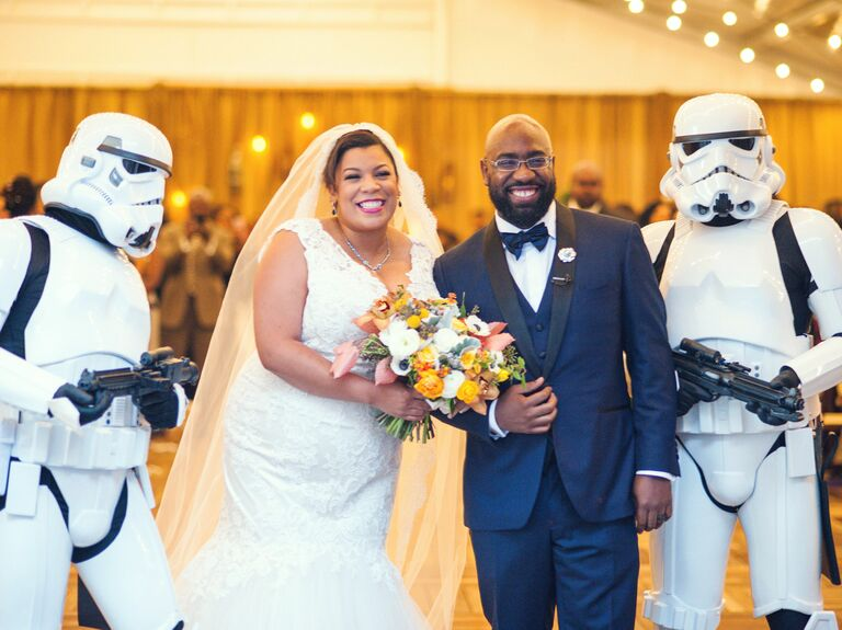 bride and groom surprised by Star Wars stormtroopers