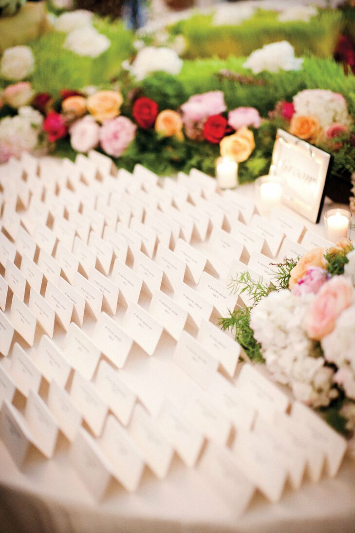 Shimmery escort cards were set in a bed of grass.