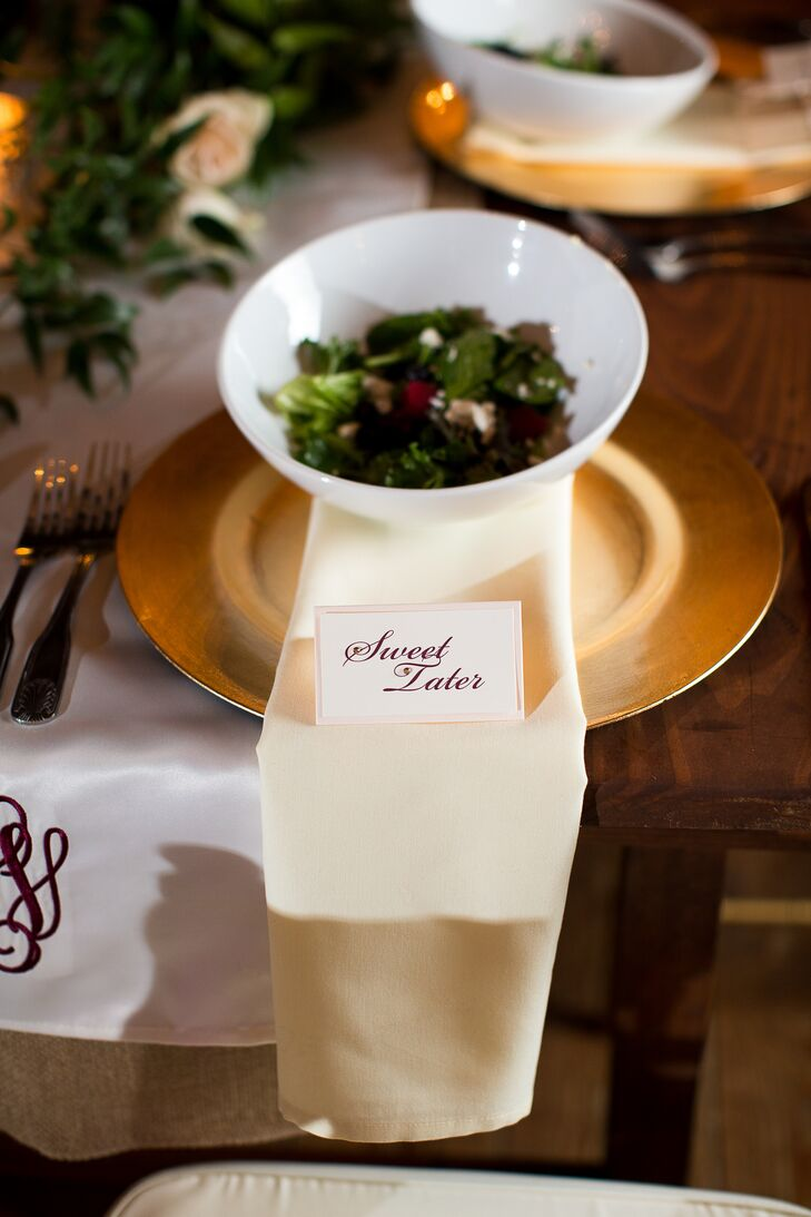 A bowl of sweet tater was placed on a gold plate with a sign in front of each guest's seat at the reception table.