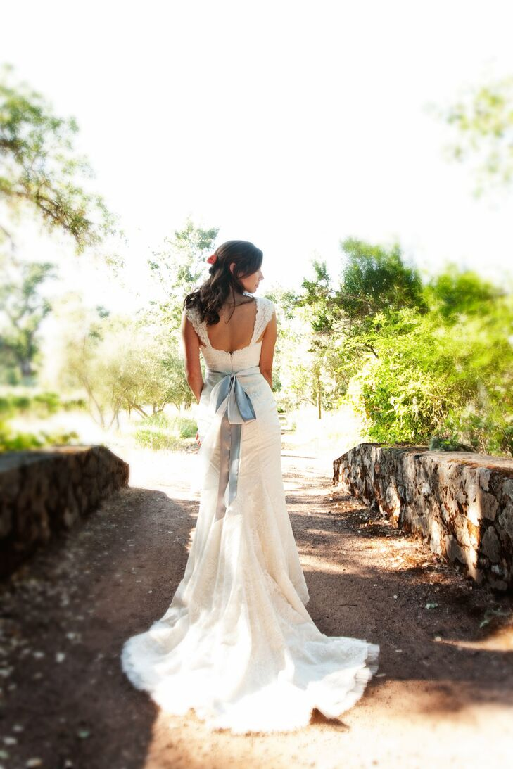 """Sara chose the fabric and the neckline of her custom lace gown. """"I couldn't have been happier with the dress and love that it was made just for me,"""" she says."""