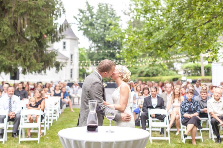 Anna and Tyler shared their first kiss as a married couple in front of their guests at J.E. Reeves Victorian Home and Museum in Dover, Ohio. On the day of the wedding, Anna wore her hair in an elegant updo with a crystal headband.
