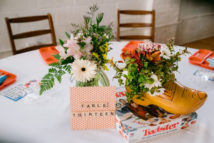 Table Numbers, Board Games and Flower Centerpieces in Wood Clogs