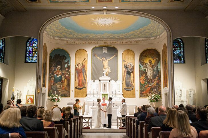 """For the ceremony, I knew I wanted to get married in the Catholic Church,"" Kathryn says. ""When looking around the Catholic churches in Charleston, I immediately fell in love with St. Mary's because of the small, intimate space and the absolutely gorgeous stained glass windows, alter and paintings."""