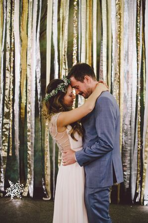 Bride and Groom by DIY Metallic Streamer Wall