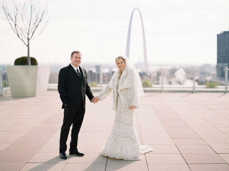 Newlyweds with St. Louis skyline in background