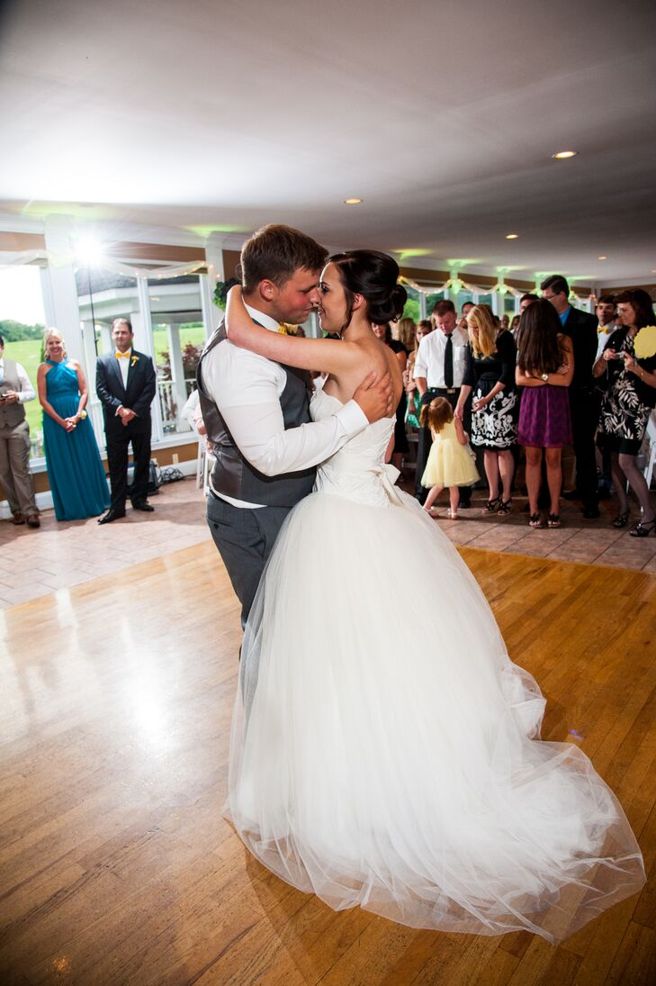 Haley and Jeremiah shared their first dance on the wooden floor inside the Morningside Inn in Frederick, Maryland, where Haley's elegant tulle skirt with a ball gown style flowed with every movement.