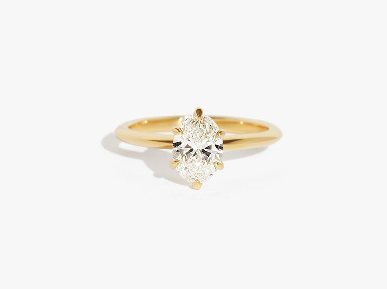 SolitaireRingJeweler oval solitaire moissanite diamond engagement ring in 14K yellow gold